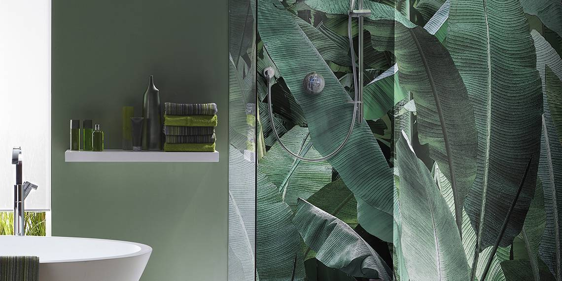 Interior of bathroom in cool green with a running shower